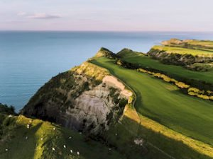 New Zealand self drive tours Cape Kidnappers luxury retreat golf tour honeymoon award ocean view tour nature