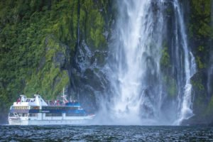 Milford Sound New Zealand water fall cruise Sightseeing self drive Tours UNESCO world heritage site cruise lakes couple travel self drive nature tour experience best holidays tour outstanding susainable eco-tours operator auckland tours